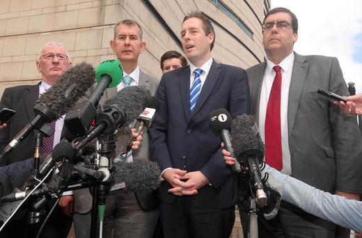 The DUP's Paul Givan(second from right) and Edwin Poots(second from left) pictured outside the court after the verdict. Press Eye - Belfast - Northern Ireland - 19th May 2015 Picture by Jonathan Porter / Press Eye