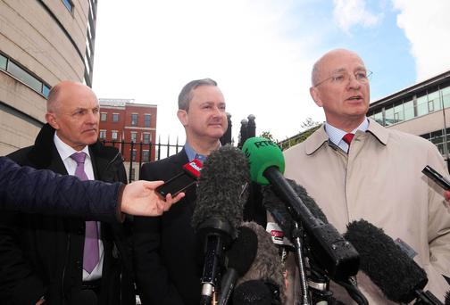 Dr Michael Wardlow(left) from the Equality Commission and Gareth Lee(centre) pictured outside the court after the verdict. Press Eye - Belfast - Northern Ireland - 19th May 2015 Picture by Jonathan Porter / Press Eye