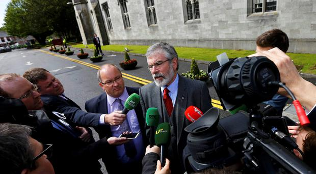 Sinn Fein president Gerry Adams speaks to the media as he arrives at the National University of Ireland in Galway
