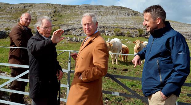 Britain's Prince Charles, Prince of Wales (C) listens as farmer Pat Nagle talks during his visit to the Burren National Park in west Ireland, on May 19, 2015. Prince Charles on Tuesday became the first British royal to meet Irish republican leader Gerry Adams, on a visit that will take him to the scene of his great-uncle's murder by the IRA. AFP PHOTO / POOL / JOHN STILLWELLJOHN STILLWELL/AFP/Getty Images