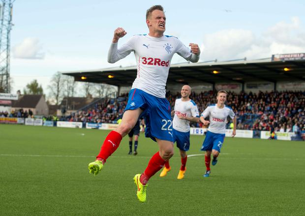 At the double: Dean Shiels celebrates his brace which saw Rangers progress from the Scottish Premiership play-off quarter-final against Queen of the South