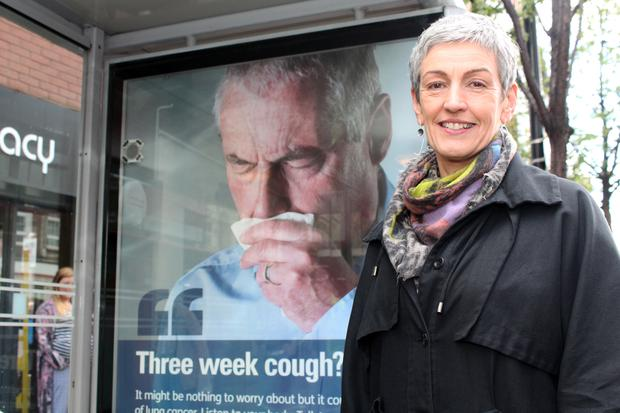 Dr Miriam McCarthy, Consultant at the Public Health Agency (PHA), at one of the 'coughing' bus shelters in Belfast.
