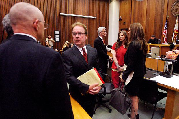 Alix Tichelman, in red, acknowledges her parents as she is surrounded by lawyers in Santa Cruz