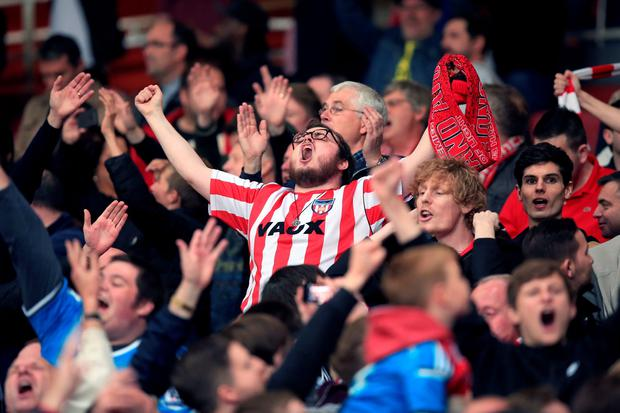 A Sunderland fan passionately showing his support after the Barclays Premier League match at the Emirates Stadium