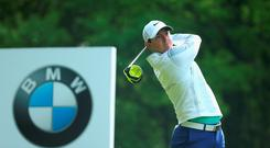 Rory McIlroy of Northern Ireland tees off on the 3rd hole during day 1 of the BMW PGA Championship at Wentworth on May 21, 2015 in Virginia Water, England.