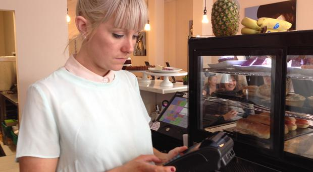Orla McKeating of Boden Park Coffee Company using her new bitcoin payment terminal