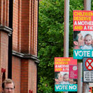 Pedestrians walk past anti same-sex marriage posters in Dublin on May 21, 2015. Ireland goes to the polls tomorrow to vote on whether same-sex marriage should be legal, in a referendum that has exposed sharp divisions between communities in this traditionally Catholic nation. AFP PHOTO / PAUL FAITHPAUL FAITH/AFP/Getty Images