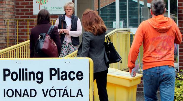Members of the public arrive to vote at a polling station in Drumcondra, north Dublin on May 22, 2015. Ireland took to the polls today to vote on whether same-sex marriage should be legal, in a referendum that has exposed sharp divisions between communities in this traditionally Catholic nation. AFP PHOTO / Paul FaithPAUL FAITH/AFP/Getty Images