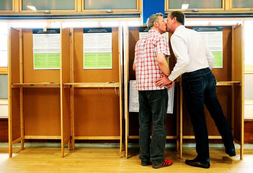 Civil partners of four years Paul Higgins (left) and Richard Lucey, who have been in a relationship together for 19 years, prepare to cast their votes at their polling station in Cabra, Dublin for the referendum on gay marriage.
