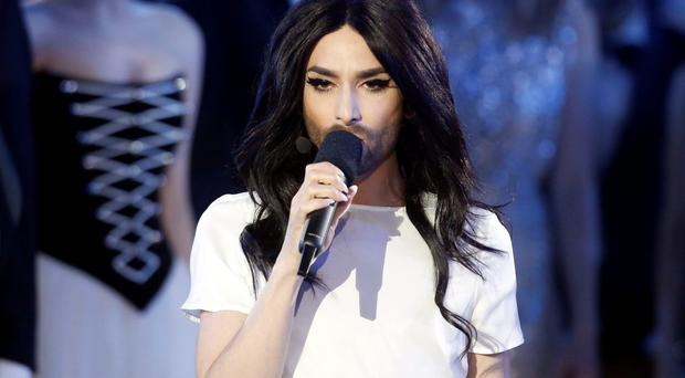 2014 winner Conchita Wurst from Austria performs ahead of the Eurovision Song Contest in Vienna.