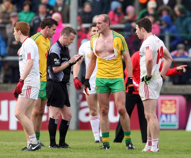 ?/Presseye.com - 17th May 2015. Press Eye Ltd - Northern Ireland - Ulster GAA Football Senior Championship Preliminary Round : Donegal vs Tyrone Match referee Joe McQullian books both Donegal's Neil Gallagher and Tyrone's Sean Cavanagh. Mandatory Credit Photo Lorcan Doherty / Presseye.com