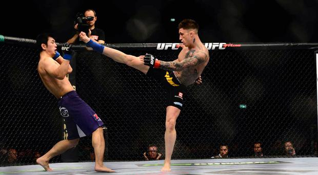 Getting his kicks: Norman Parke nearly connects with his right foot against Naoyuki Katuni during a UFC clash at the O2 in Dublin