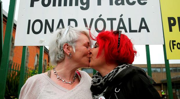 Lesbian couple Helen Brassil (left) and Sharon Webb after casting their vote at St James Primary School, Dublin, in the referendum on gay marriage yesterday