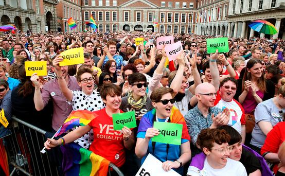 People gather at the Central Count Centre in Dublin Castle, Dublin, after Zappone proposed live on TV as votes are continued to be counted in the referendum on same-sex marriage. Brian Lawless/PA Wire.