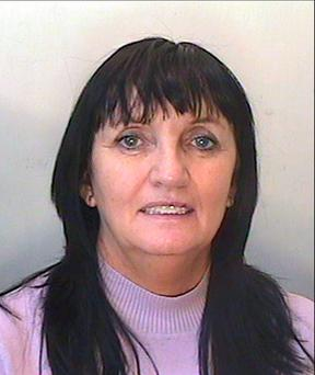 Photo issued by the PSNI of suspected fraudster Julia Holmes. PSNI/PA Wire.