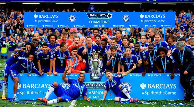 Chelsea players celebrate with the trophy after the Barclays Premier League match at Stamford Bridge, London. Nick Potts/PA Wire.