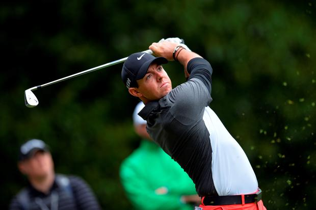 Northern Irish golfer Rory McIlroy watches his drive from the 2nd tee on the second day of the PGA Championship at Wentworth Golf Club in Surrey, south west of London, England, on May 22, 2015. AFP PHOTO/GLYN KIRKGLYN KIRK/AFP/Getty Images