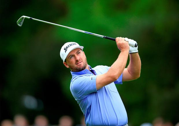 VIRGINIA WATER, ENGLAND - MAY 22: Graeme McDowell of Northern Ireland hits his 2nd on the 15th hole during day 2 of the BMW PGA Championship at Wentworth on May 22, 2015 in Virginia Water, England. (Photo by David Cannon/Getty Images)