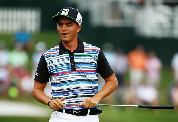 PONTE VEDRA BEACH, FL - MAY 08: Rickie Fowler reacts on the 17th green during round two of THE PLAYERS Championship at the TPC Sawgrass Stadium course on May 8, 2015 in Ponte Vedra Beach, Florida. (Photo by Richard Heathcote/Getty Images)