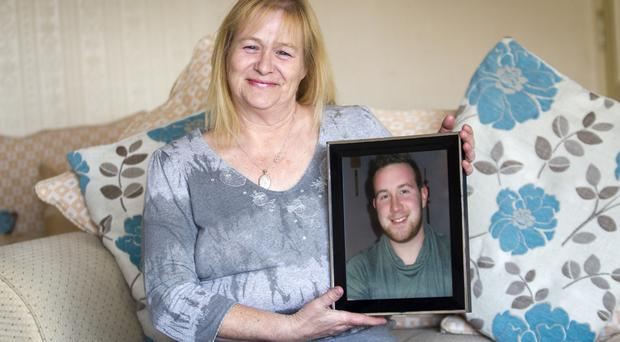 Pictured Daniel's mum Pauline Mills holding a picture of Daniel. By Liam McBurney