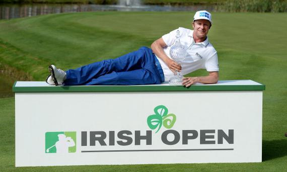 CORK, IRELAND - JUNE 22: Mikko Ilonen of Finland celebrates with the winners trophy after the final round of the Irish Open at the Fota Island Resort on June 22, 2014 in Cork, Ireland. (Photo by Ross Kinnaird/Getty Images)