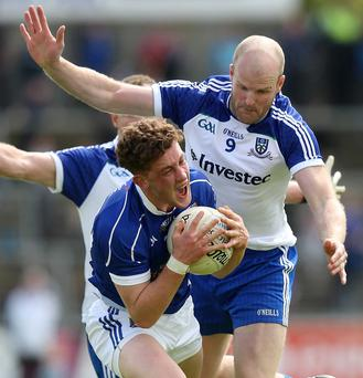 Closing in: Monaghan's Dick Clerkin bears down on Cavan ace Ciaran Brady during the clash at Breffni Park