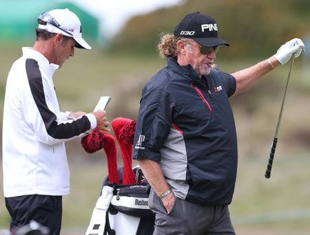 Warming up: Miguel Angel Jimenez gets into the swing of things at the Royal County Down course