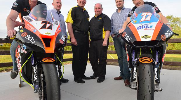 Twin boost: IJ Lynn and Sons and McAuley Car Dismantlers, have come on board as joint sponsors of the Supertwins race at the Armoy Road Races. Pictured here are: (L-R) racer Ryan Farquhar, Conor McAuley of McAuley Car Dismantlers, Bill Kennedy, Clerk of the Course, Davy Guild of Armoy Road Races, Ivan Lynn of IJ Lynn&Sons and racer Jeremy McWilliams