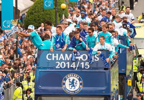 Only bus that matters: Chelsea show off the Premier League crown during their parade through the streets of London yesterday