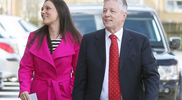 Peter Robinson and his daughter Rebekah walk to the polling booth earlier this month