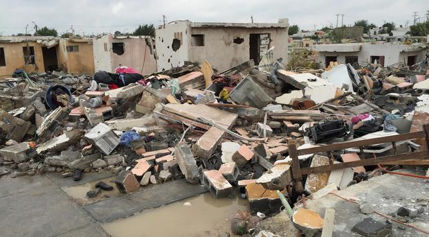 Damaged homes stand next to others that were razed when a powerful tornado touched down in Ciudad Acuna, northern Mexico, Monday, May 25, 2015.