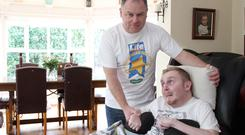 Support: John McMullan is a full time carer for his son Declan who has Locked-in Syndrome. Pic: Colm O'Reilly/Sunday Life.