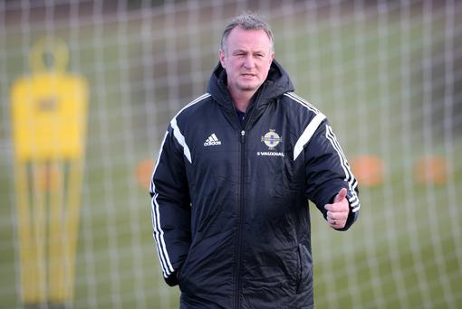 Michael O'Neill and his Northern Ireland side welcome Romania to Windsor Park next month