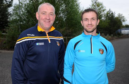 Big match: Antrim boss Frank Fitzsimons (left) will look to Tony Scullion to put his experience to good use against Fermanagh