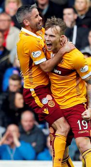 All's Well: Motherwell's Lee Erwin celebrates his goal with team-mate Keith Lasley