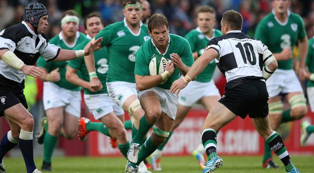 Returning hero: Chris Henry on the charge for Ireland against the Barbarians in Limerick PRESSEYE