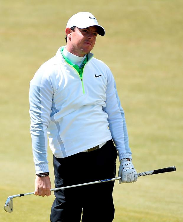 A dejected Rory McIlory after he failed to make the cut for the final two days of the Irish Open yesterday