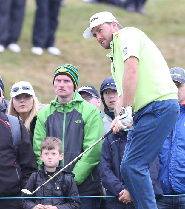 Touch of class: Graeme McDowell chips to the 11th green in the Dubai Duty Free Irish Open at Royal County Down PRESSEYE