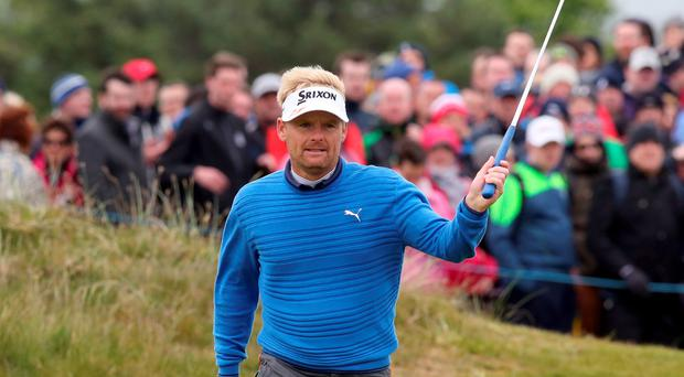 Soren Kjeldsen of Denmark waves to the crowd on the 18th hole on the third day of the Irish Open at the Royal County Down Golf Club in Newcastle in Northern Ireland on May 30, 2015. AFP PHOTO / PAUL FAITHPAUL FAITH/AFP/Getty Images