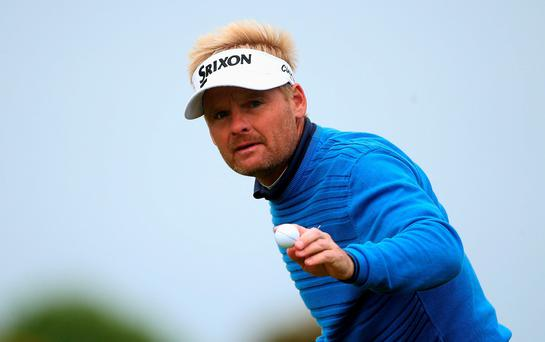 Denmark's Soren Kjeldsen acknowledges the crowd on the 16th green during day three of the Dubai Duty Free Irish Open at Royal County Down Golf Club, Newcastle.