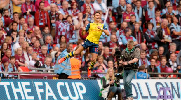 Arsenal's Alexis Sanchez celebrates scoring his side's second goal during the FA Cup Final at Wembley Stadium, London.