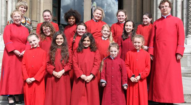 Pictured with some of the schoolchildren are assistant Master of the Choristers Terese Woodfield, head of Vocal Tuition Catherine Harper and Master of the Choristers David Stevens, outside St Annes Cathedral. Pic: Colm O'Reilly/ Sunday Life.
