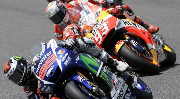 Lean machines: winner and Yamaha rider Jorge Lorenzo leads Honda's Marc Marquez, and Ducati pair Andrea Dovizioso and Andrea Iannone in yesterday's Italian MotoGP