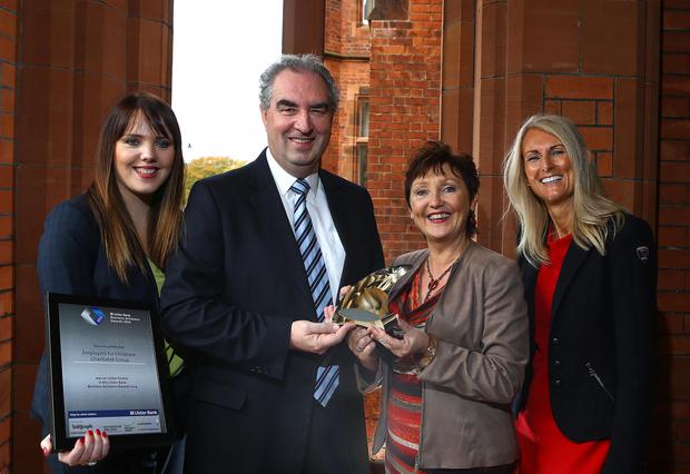 Colin Jess of Ulster Bank presented (from left) Clare Greenwood, Marie Marin and Zara Duffy from Employers for Childcare with their 2014 award