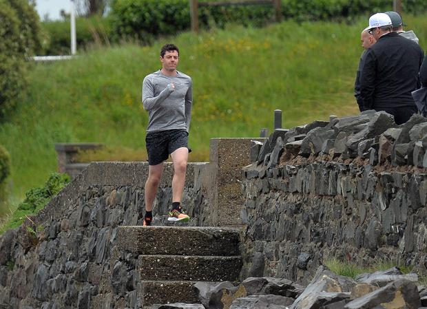 PACEMAKER BELFAST 01/06/2015 On a miserable rainy Monday the Worlds No 1 Golfer Rory McIlroy didnt let the weather get to him, pictured here running along the Co Down shore line in his home town of Holywood. Apparently he is filming a new advert for his main sponsor Nike in Northern Ireland today. We photographed him earlier in the day at Bangor Golf club. Photo Colm Lenaghan/Pacemaker Press