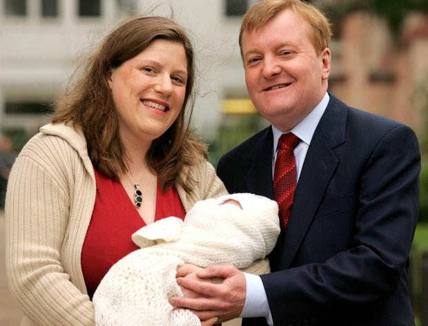Charles Kennedy and his wife Sarah posing for pictures with their newborn son Donald James Kennedy in 2015.