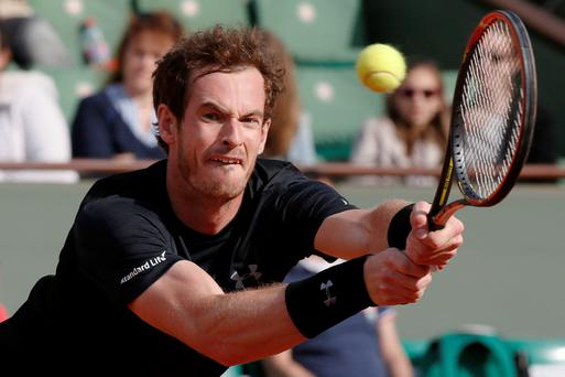 Big hit: Andy Murray prepares to take on David Ferrer in his 17th consecutive Slam quarter-final