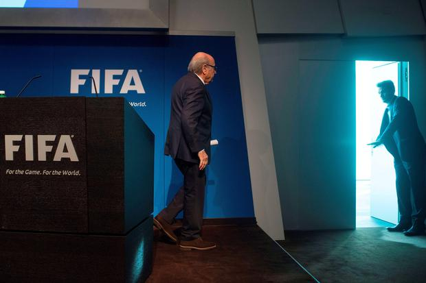 Out the door: Sepp Blatter's reign as President of Fifa is over after his shock resignation announcement