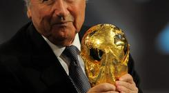 Hands on: Sepp Blatter with the World Cup trophy