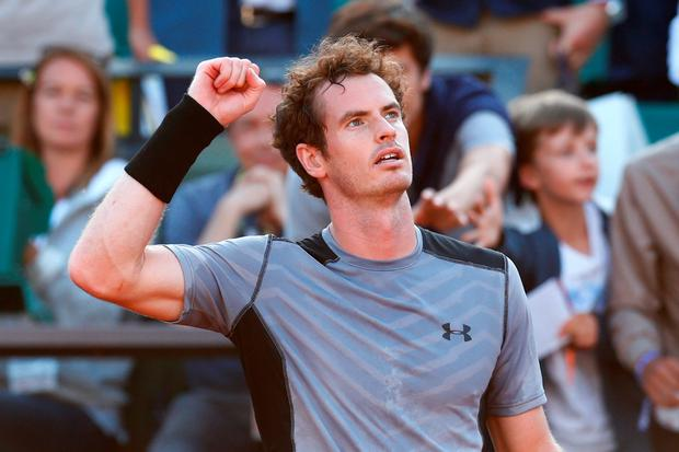 Scotland's Andy Murray celebrates match point in his Men's quarter final match against David Ferrer of Spain on day eleven of the 2015 French Open at Roland Garros on June 3, 2015 in Paris, France. (Photo by Julian Finney/Getty Images)